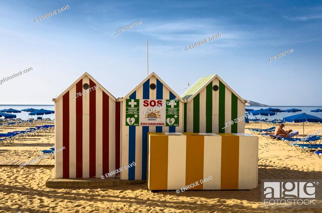 Stock Photo: View of a colour cabins on the Benidorm beach, Alicante north, Spain.