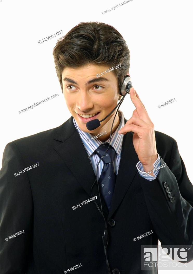 Stock Photo: Close-up of a businessman wearing a headset and smiling.