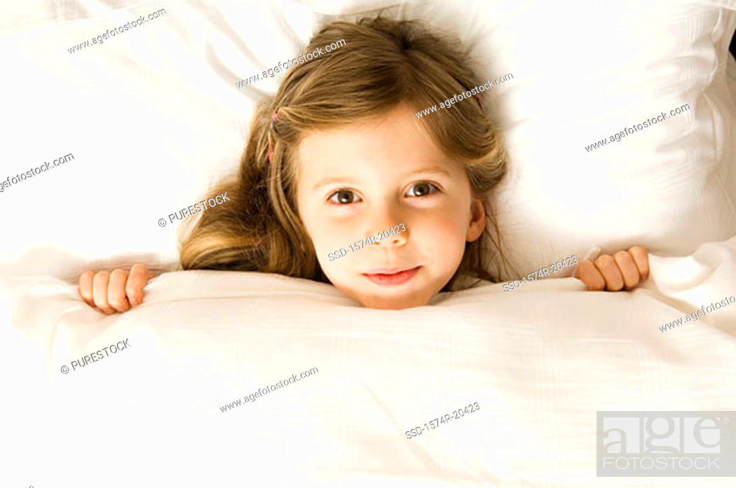 Stock Photo: Portrait of a girl lying in the bed.