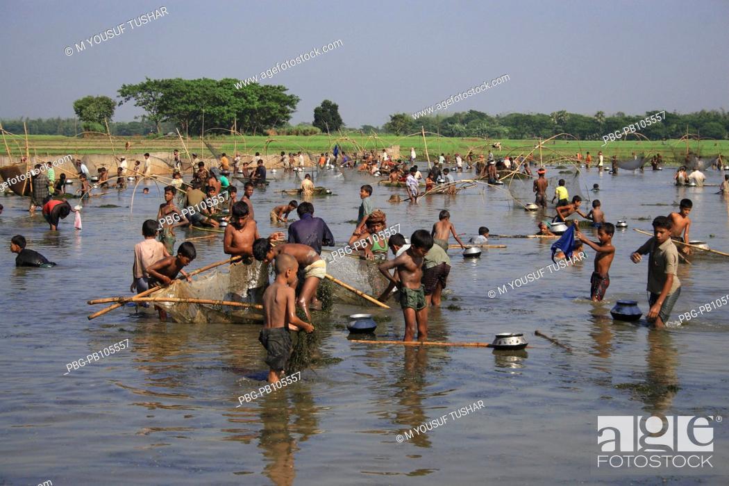 Stock Photo: Fishermen catch fishes in the flooded water Narsingdi, Bangladesh November 2006.
