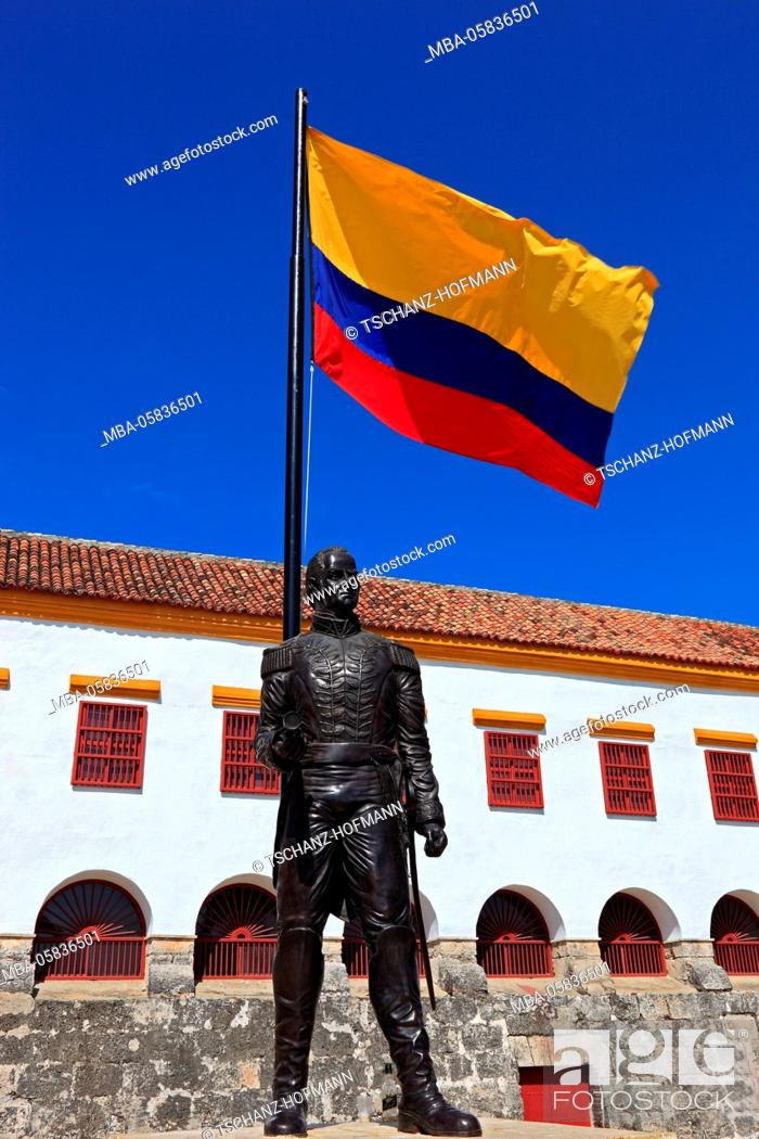Stock Photo: Republic Colombia, Departamento Bolivar, city of Cartagena de Indias, statue of Jose Padilla with land flag in front of the Jesuits cloister.