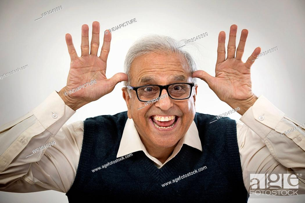 Stock Photo: Happy old man making funny face.