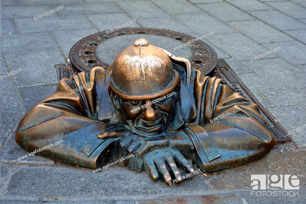 Stock Photo: Cumil statue in the Laurinsky street of the Slovak capital Bratislava - Slovakia.
