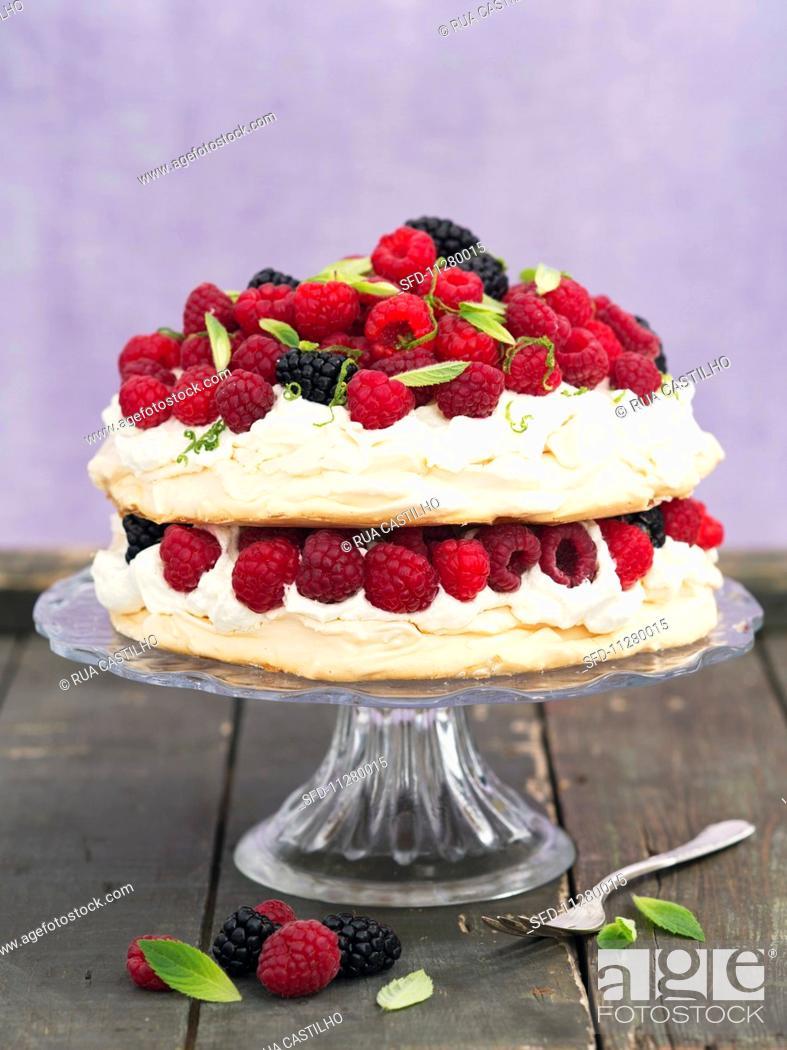 Stock Photo: Pavlova with raspberries and blackberries.
