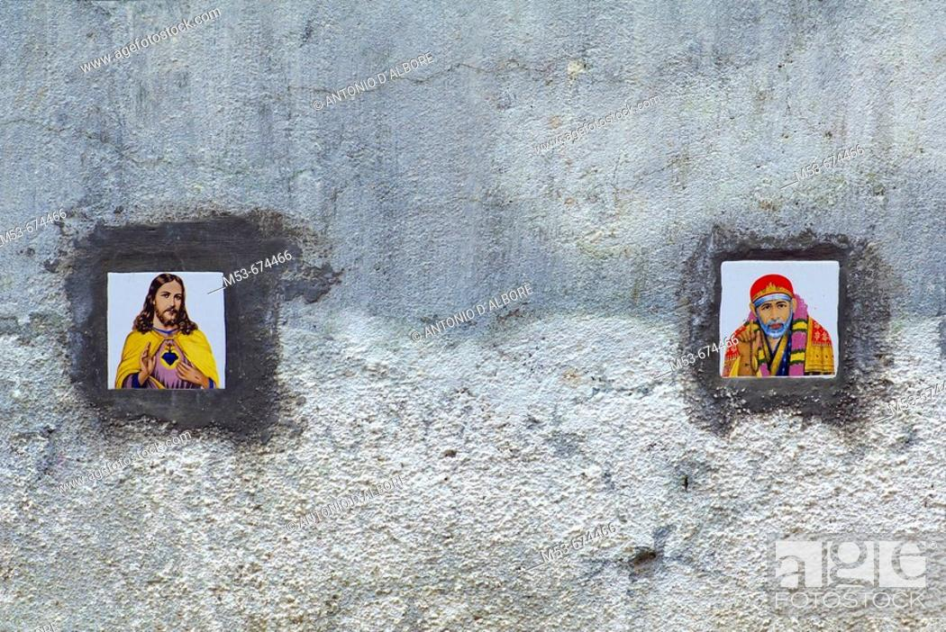 Stock Photo: Tiles with images of Jesus Christ and Shirdi Sai Baba on the external wall of a residential condominium in Santacruz district, Mumbai, Maharashtra, India.