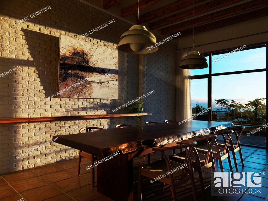 Imagen: Large wooden dining table in contemporary home at sunset.