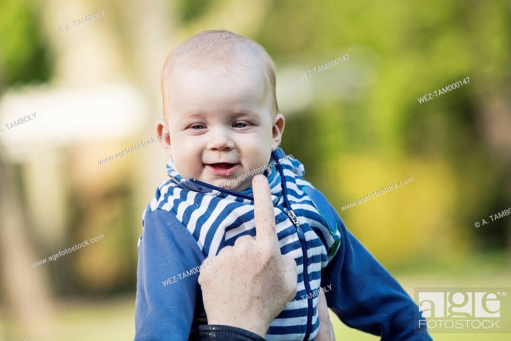 Stock Photo: Portrait of smiling baby boy.