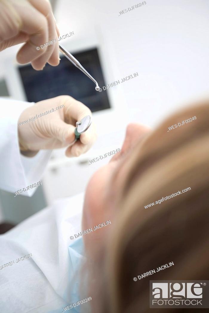 Stock Photo: Germany, Bavaria, Landsberg, Girl 8-9 having dental treatment.