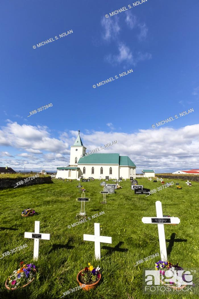 Stock Photo: Exterior view of the cemetery at Reynihlíð Church just outside of Akureyri, Iceland.