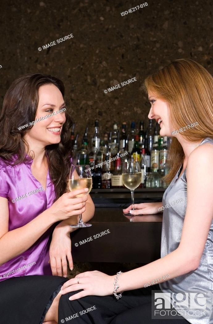 Stock Photo: Two women drinking in a bar.