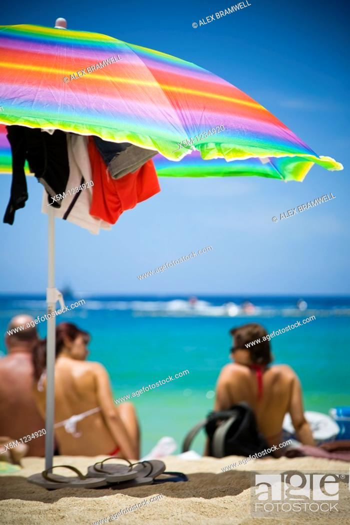 Stock Photo: Colorful beach scene with parasol.