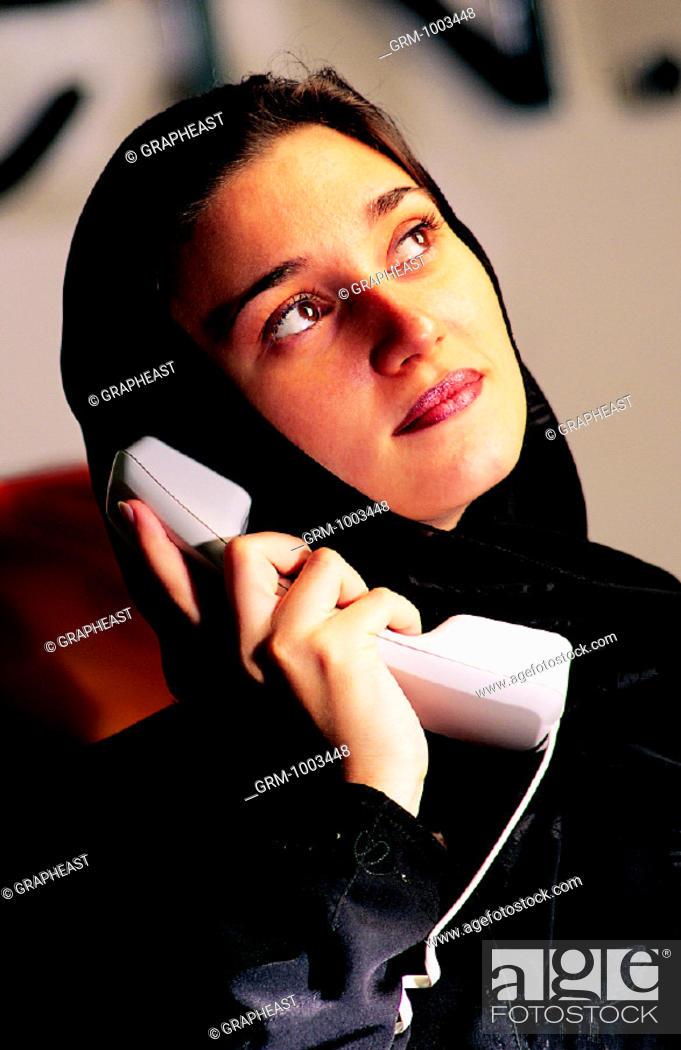 Stock Photo: Arab businesswoman speaking on the telephone.