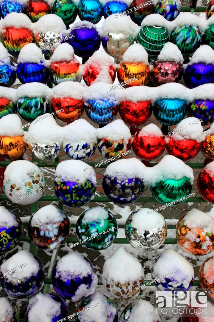 Stock Photo: collection of colored glass balls decoration in garden in winter with snow.