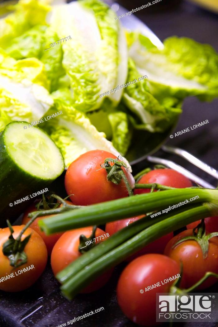 Stock Photo: Romaine lettuce, tomatoes, cucumber and chives.