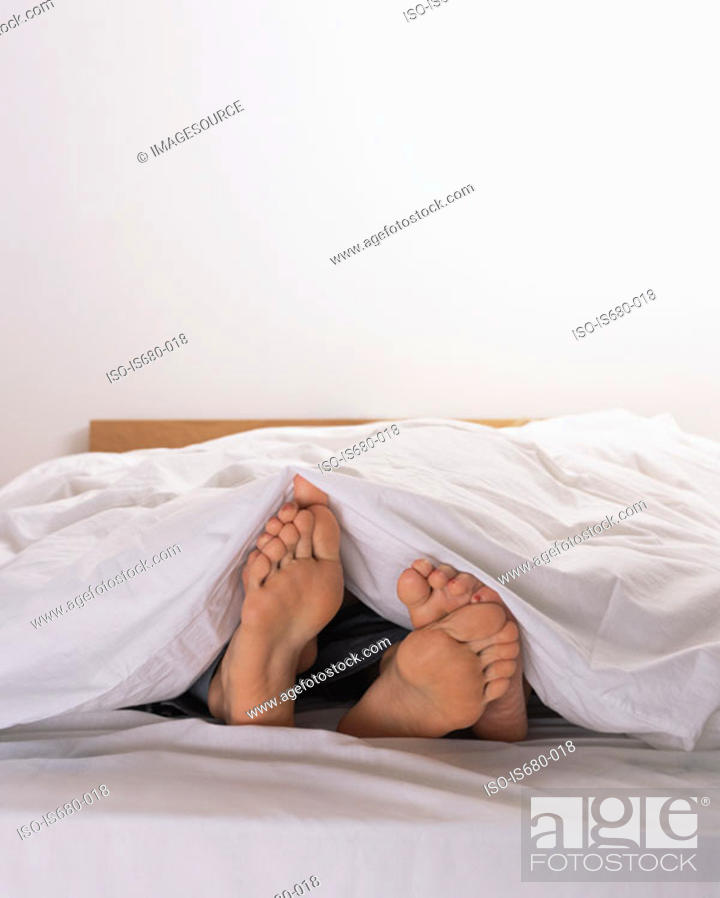 Stock Photo: Man and woman in bed.