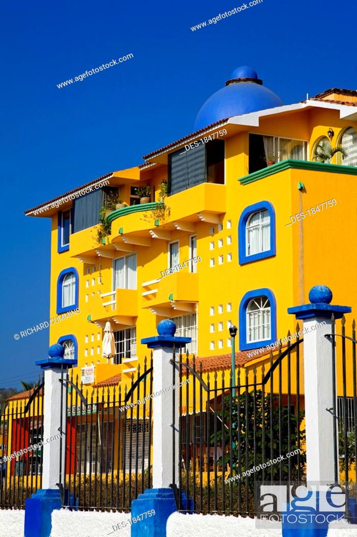stock photo santa cruz huatulco oaxaca state mexico gate in front of colorful hotel