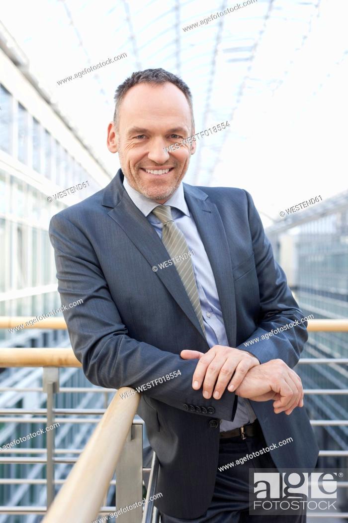 Stock Photo: Germany, Leipzig, Businessman smiling, portrait.