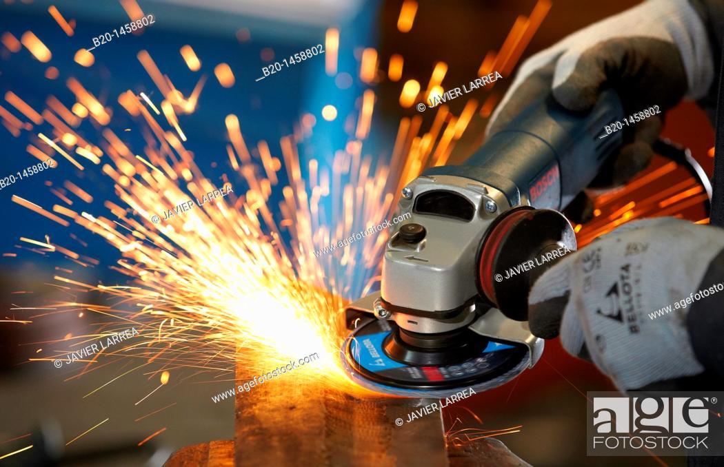 Stock Photo: Rough grinding, forging, metalworking process, grinding machine with abrasive wheel, metallurgy, Legazpi, Gipuzkoa, Euskadi, Spain.