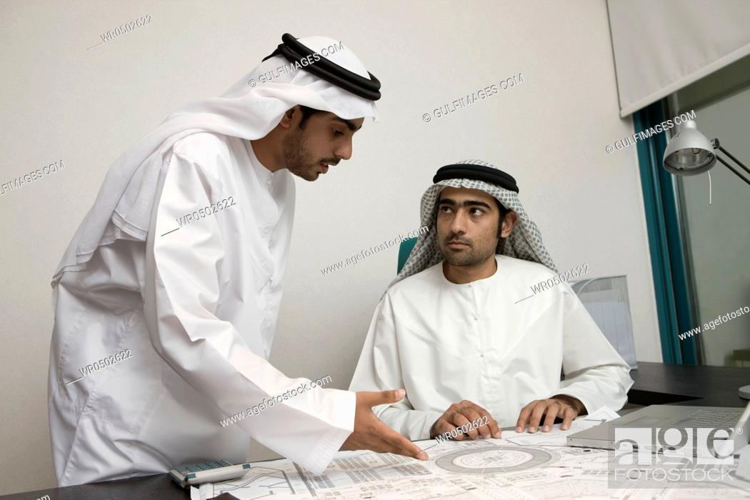 Stock Photo: Two Arab businessmen discussing at work.