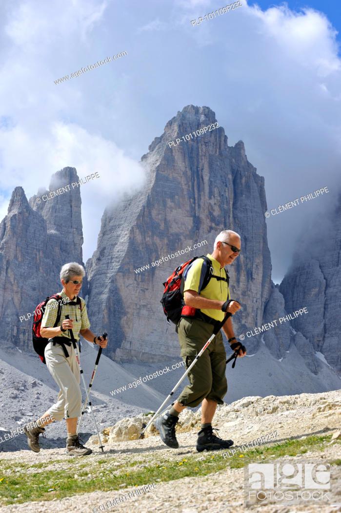 Stock Photo: Couple of elderly mountain walkers in front of the Tre Cime di Lavaredo / Drei Zinnen, Dolomites, Italy.