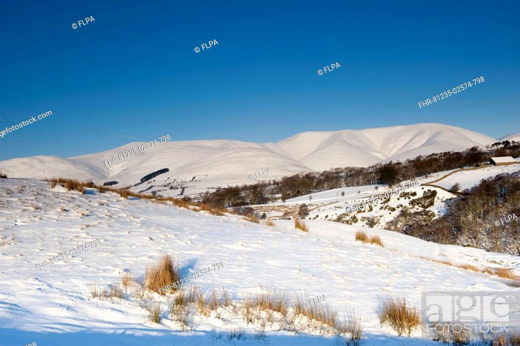 Stock Photo: View of snow covered upland landscape, Eastern Howgills, from above Sedbergh, near Garsdale, Cumbria, England, winter.