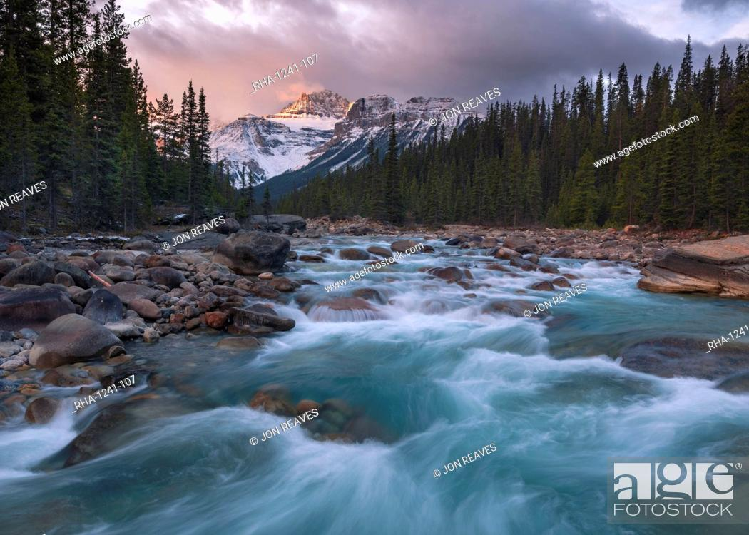 Stock Photo: Sunrise and glacial blue rushing waters at Mistaya Canyon, Banff National Park, UNESCO World Heritage Site, Alberta, The Rockies, Canada, North America.