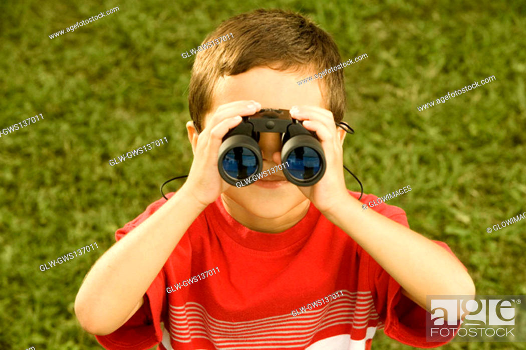 Stock Photo: High angle view of a boy looking through a pair of binoculars.