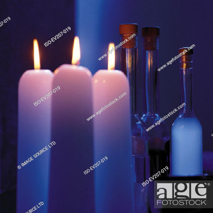 Stock Photo: Bottles and candles.