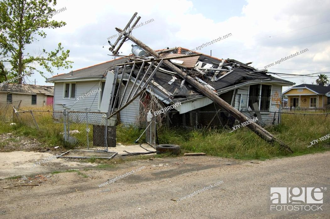 Stock Photo: A power pole fell on top of a home in the Lower Ninth Ward, New Orleans.