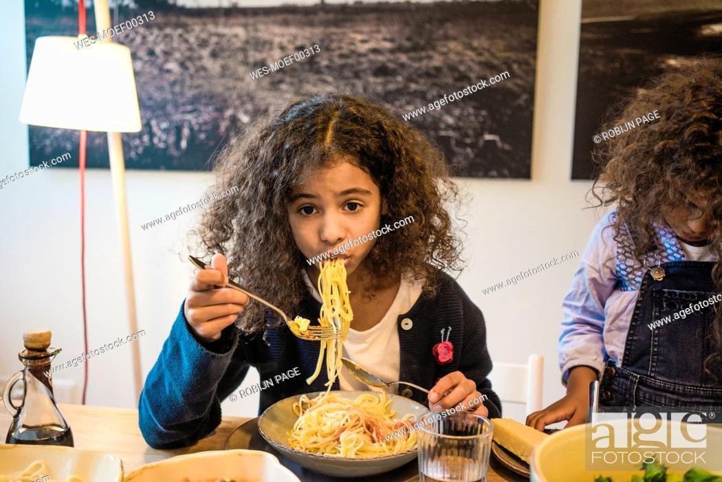 Stock Photo: Little girl eating tasty spaghetti.