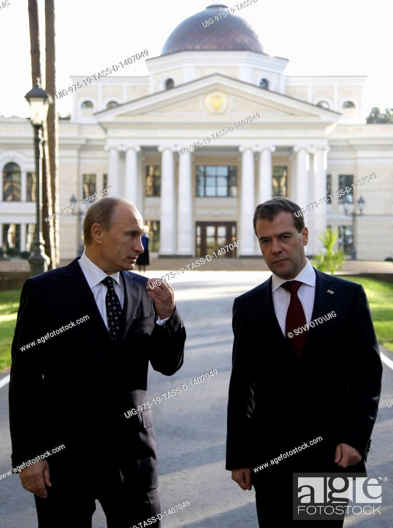 Stock Photo: Moscow region, russia, october 1, 2010, president of russia dmitry medvedev (r) and prime minister vladimir putin chat during a walk at gorki residence.
