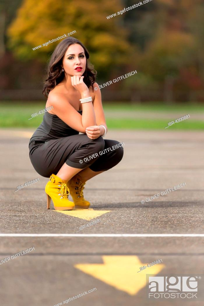Stock Photo: Young woman in green jumpsuit, fashion.