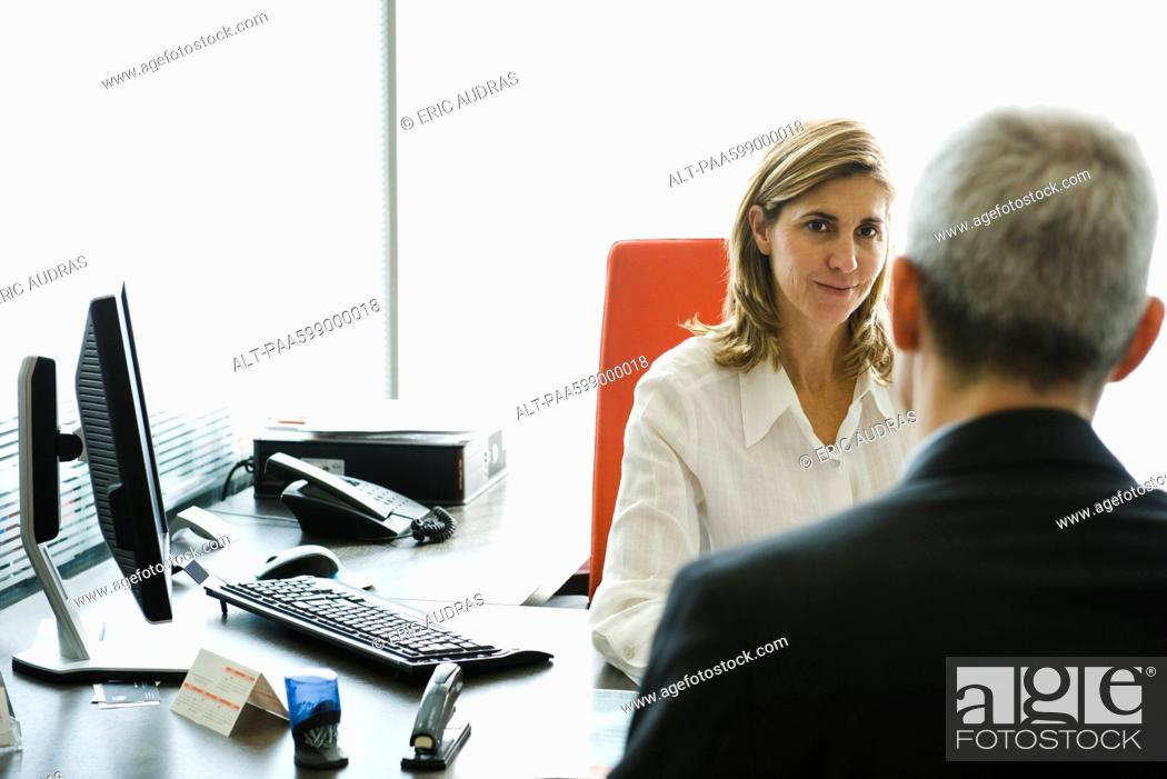 Stock Photo: Businesswoman meeting with client in office.