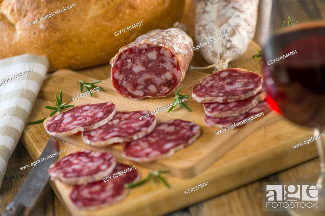 Stock Photo: French salami Sausage on a wooden table, France.