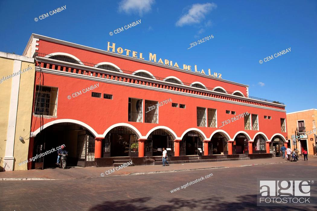 Stock Photo: Street scene from the town center with Hotel Maria de la Luz in the foreground, Valladolid, Yucatan Province, Mexico, Central America.