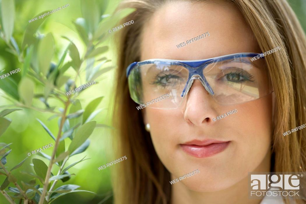 Stock Photo: Europe, Germany, North Rhine Westphalia, Duesseldorf, Young student with plant, close up.