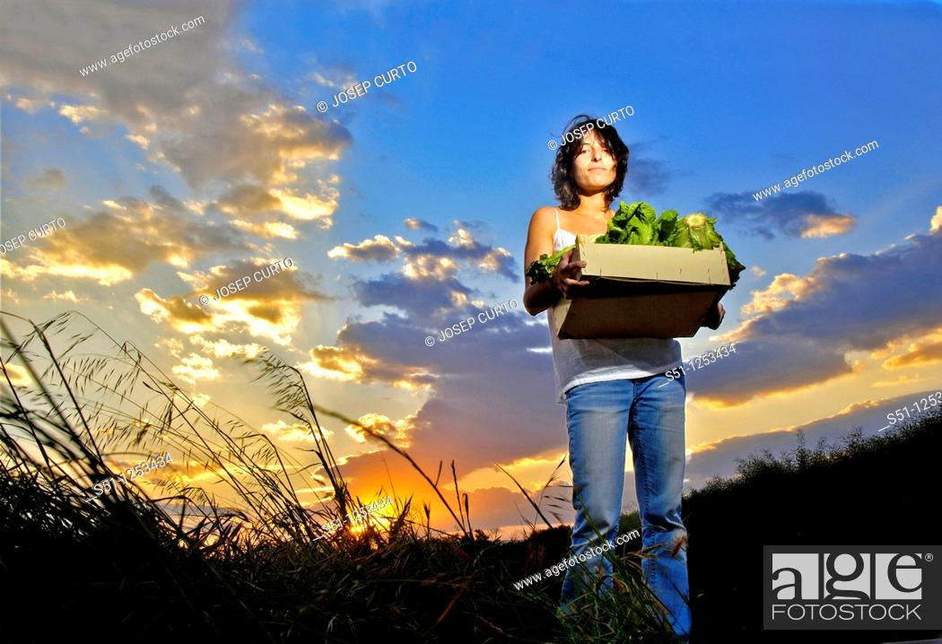 Stock Photo: Girl with lettuce box.