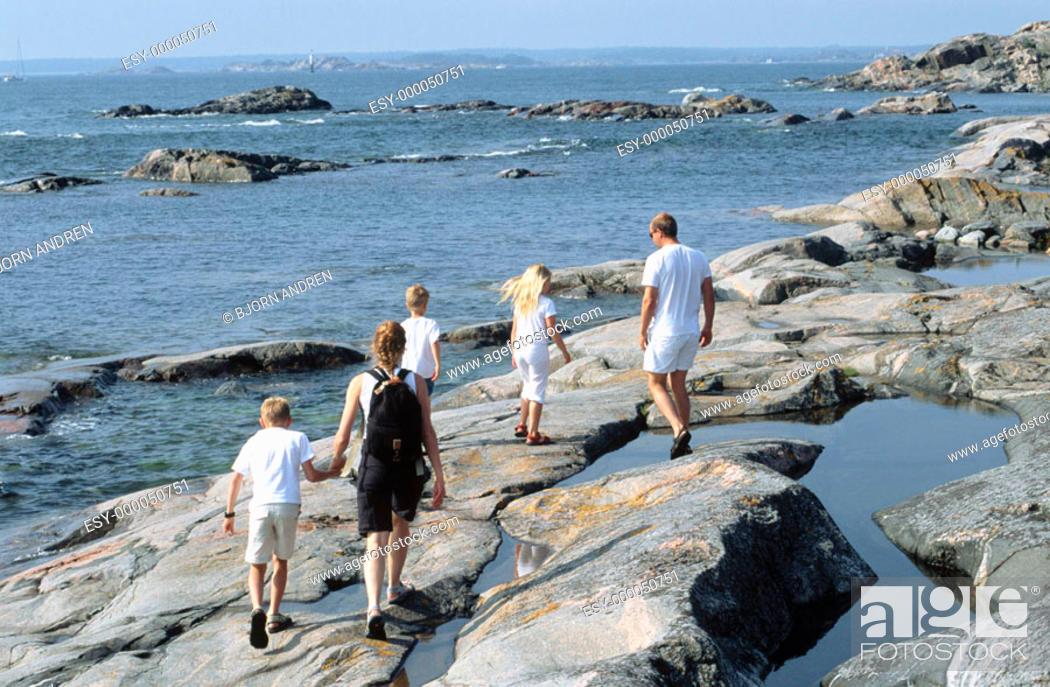 Stock Photo: Family hiking on coastline.
