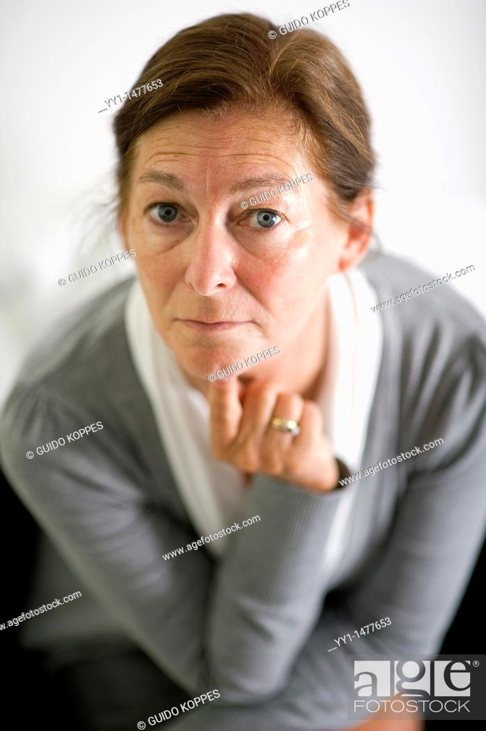 Stock Photo: Portrait of a middle-aged woman, working as a secretary / management assistant. Studio-portait.