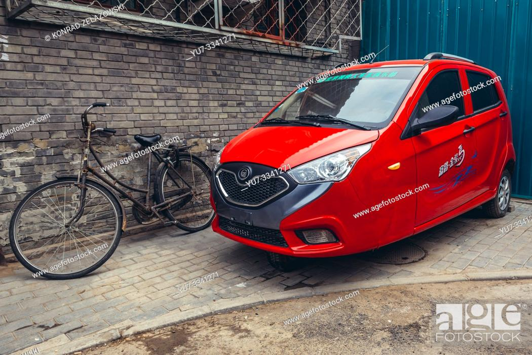Stock Photo: Three-wheeled car in traditional hutong residential area in Dongcheng district of Beijing, China.