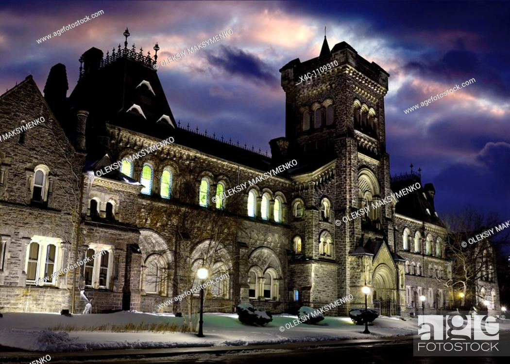 Stock Photo: University College at night at University of Toronto Canada Artistic wintertime scenery with dramatic red blue sky.