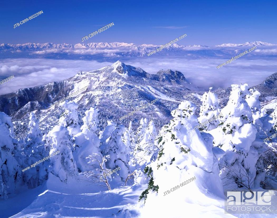 Stock Photo: Silver frost A shade is a mountain. North Alps Shiga highland Nagano Japan Sky Mountain Snow Snow-covered mountain Snow-covered landscape Clouds.