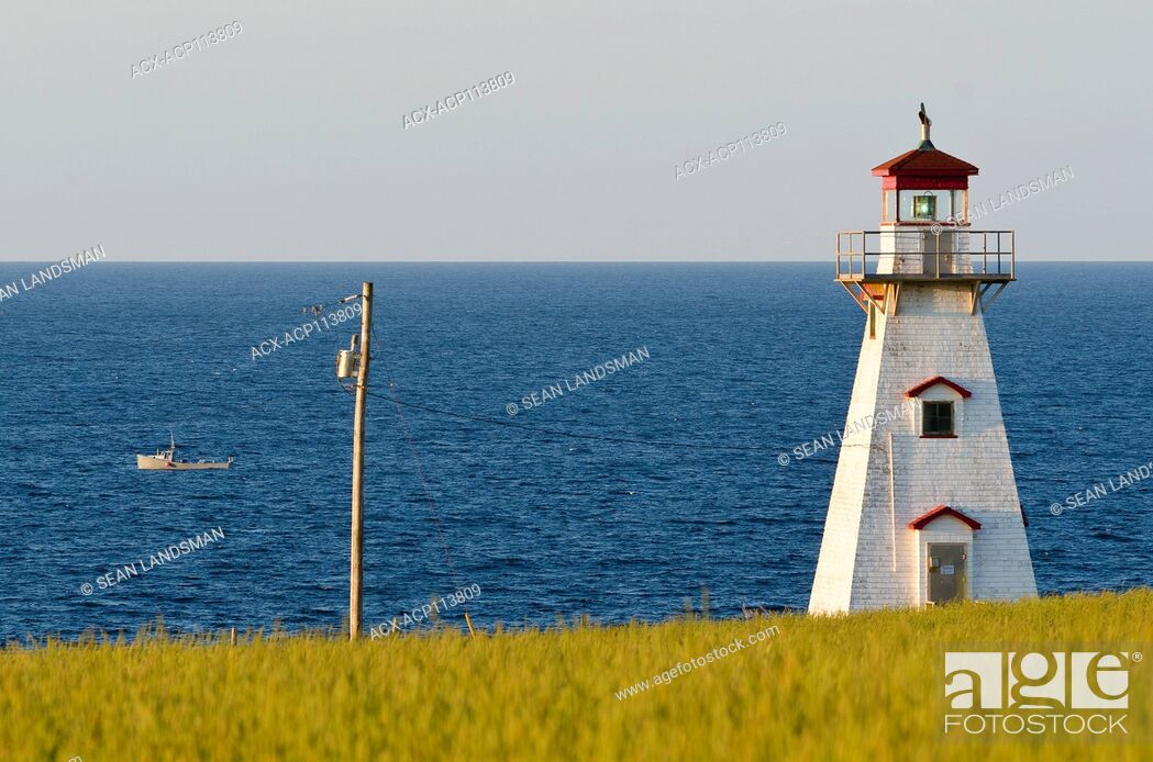 Stock Photo: Cape Tryon Lighthouse, Cape Tryon, Prince Edward Island, Canada, lobster boat.
