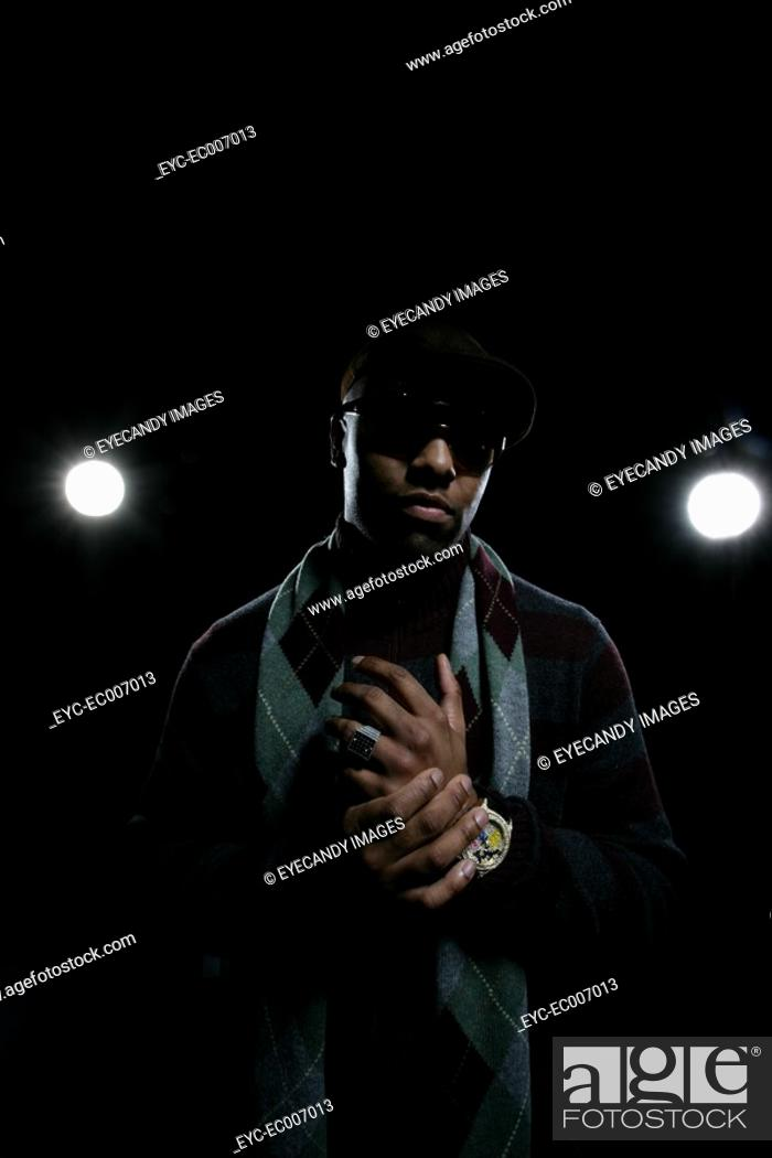 Stock Photo: African-American man standing in front of studio lights.