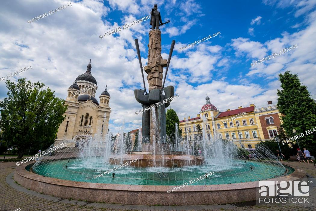Stock Photo: Avram Iancu statue and fountain and Romanian Orthodox Cathedral of Dormition of the Theotokos on Avram Iancu Square in Cluj Napoca city in Romania.