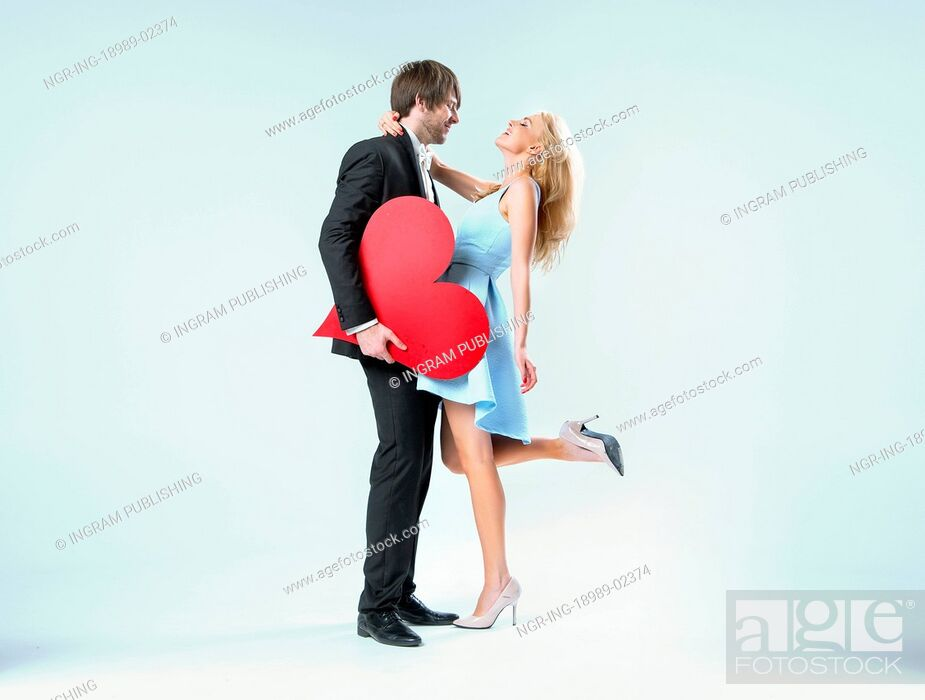 Stock Photo: Cheerful valentine's couple in the hug.