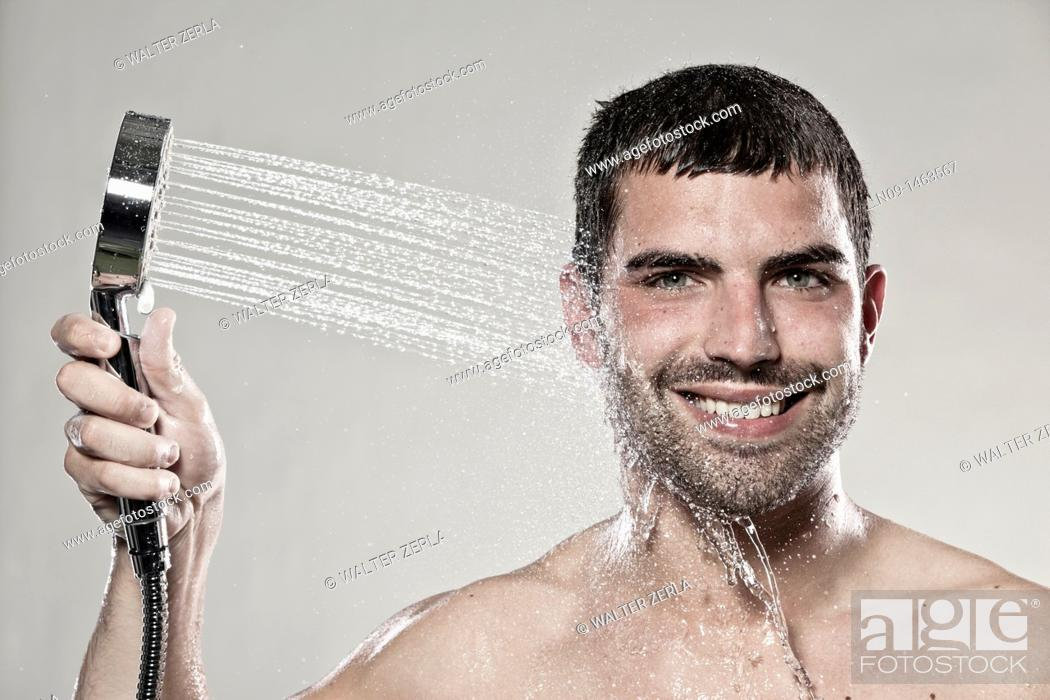 Stock Photo: Man takes a shower.