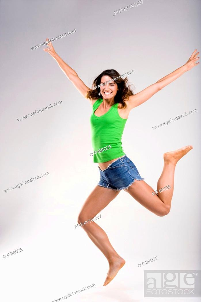 Stock Photo: Woman jumping in excitement.