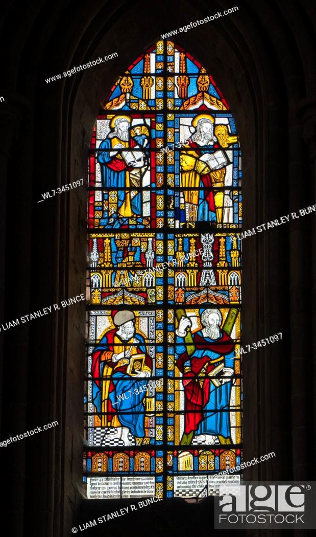 Stock Photo: Seventeenth century stained glass depicting Evangelists in the upper section and Apostles in the lower section, Dore Abbey Herefordshire UK.
