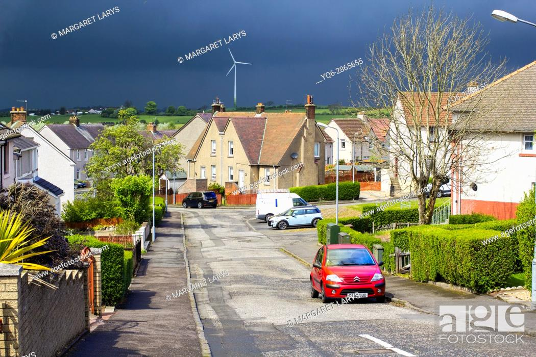 Stock Photo: Airdrie, North Lanarkshire, Scotland, UK. Streets of Airdrie during cloudy weather and heavy rain coming changing the weather from very warm and sunny into.